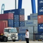 China's politically charged trade surplus shrank for the third year in a row in 2011
